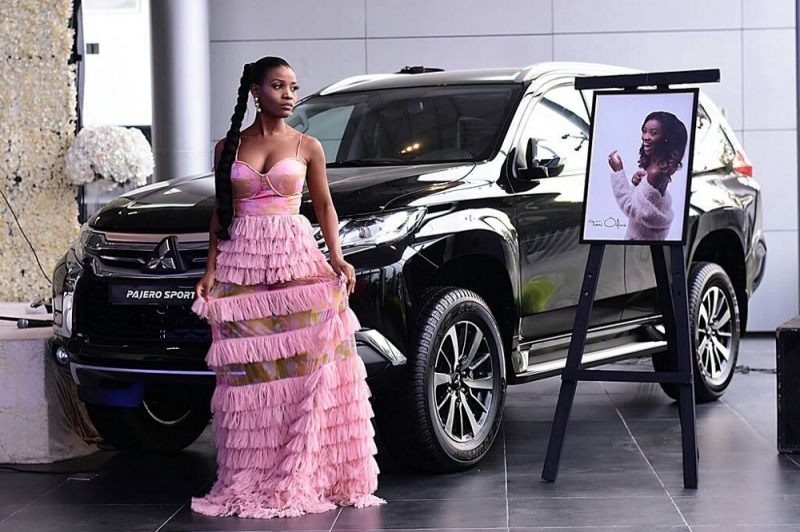 Tomi Odunsi stunning in pre-event photoshoot with the Pajero Sport